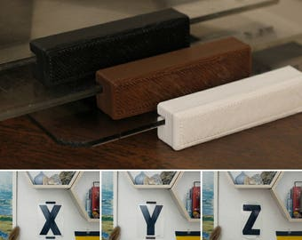 """Black 6"""" Zip Letter mounted in Floating Frame"""
