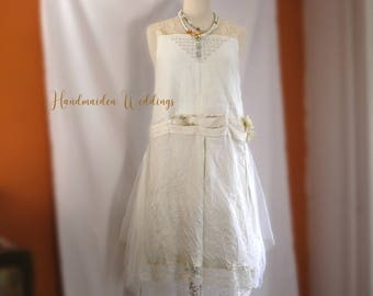 Manon rustic linen ivory wedding dress. Bohemian wedding dress with white tulle and vintage blue sequins. Easy to wear design. Size medium.