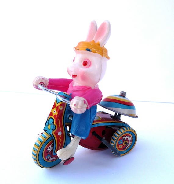 Vintage 1950's Tin and Plastic Wind-up Toy Bunny on Bike made in Japan