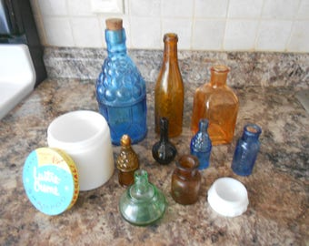 Nine Vintage Apothecary bottles ,medicine bottles, with two white milk glass from 50s