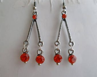 Silver Tone Earrings with Red Crystal Dangles