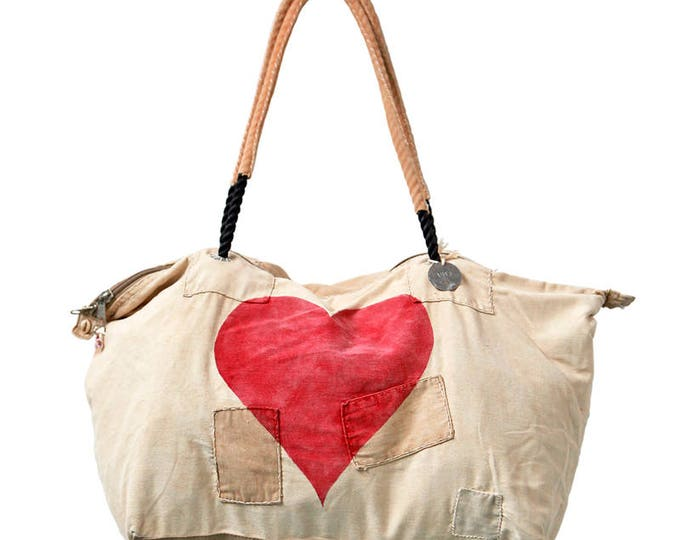 Featured listing image: Ali Lamu Large Weekend Bag Heart Red
