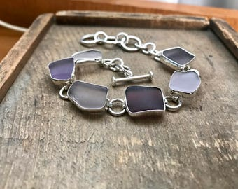 Beautiful sterling silver purple beach glass bracelet