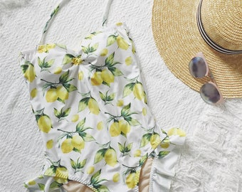 One piece strapless with ruffle bottom swimsuit in lemon print in White