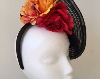 Stunning black round fascinator with red and orange flowers on a black headband!