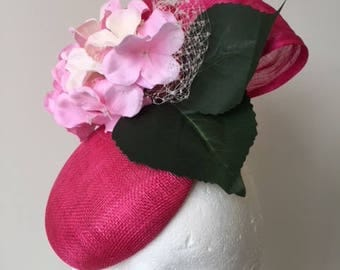New hot pink fascinator with silk abaca loops, hydrangers and white netting!