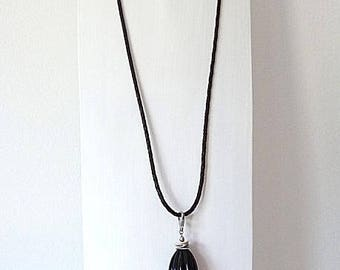 Brown braided leather necklace with silver pendant, coconut tile and horn