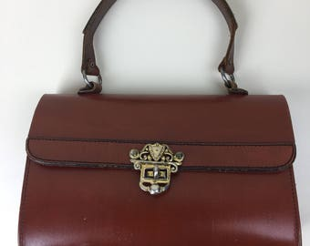 brown leather top handle satchel w/brass feet & hardware 60s