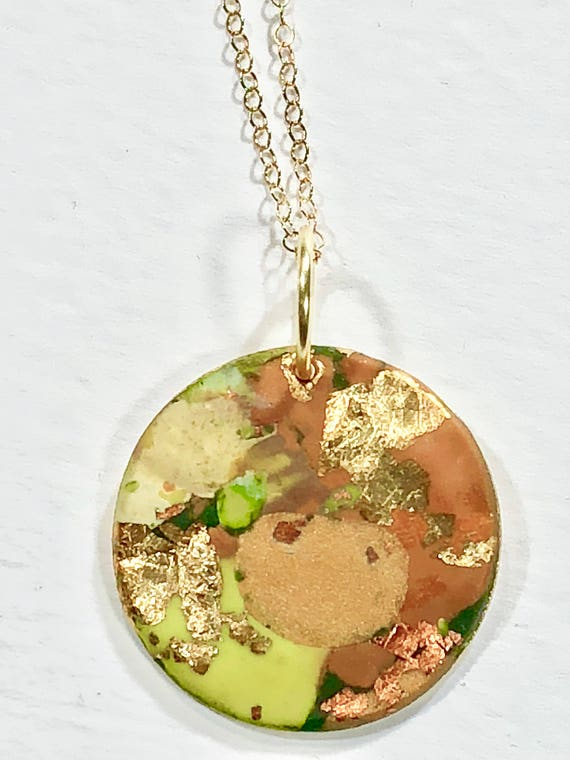 Handmade orange/green/ocre/gold/copper polymer clay round pendant necklace with abstract asymmetric design