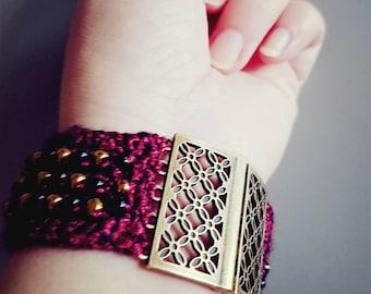 Red gold black festive beaded crochet bracelet