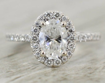 Oval Brilliant in a French Pavé Halo V-Gallery Engagement Ring in White