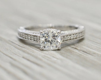 Cushion Brilliant in a Bead-set Three-sided Motif Hidden Halo Engagement Ring in White