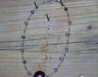 Pink glass floating bead necklace