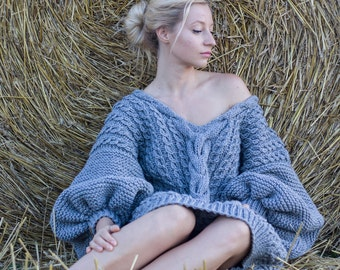 sweater handmade of natural wool with voluminous sleeves