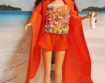 Handmade beach attire. Barbie clothes, orange shorts, skirt, shawl, crochet hat and bag, orange shoes.