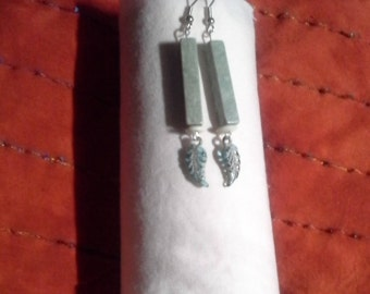 Pale green stone and glass dangling earrings