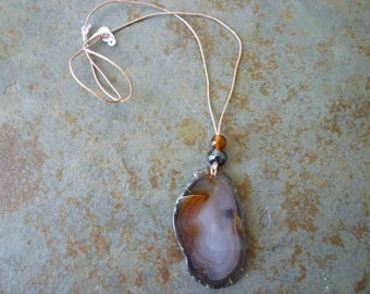Grey and orange natural agate slice pendant