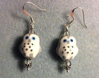 Grey and white spotted ceramic owl bead earrings adorned with grey Czech glass beads.