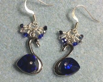 Silver and dark blue Swarovski crystal swan charm earrings adorned with tiny dangling dark blue and silver Chinese crystal beads.
