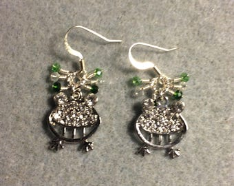 Silver and clear silly rhinestone frog charm earrings adorned with tiny dangling green and clear Chinese crystal beads.