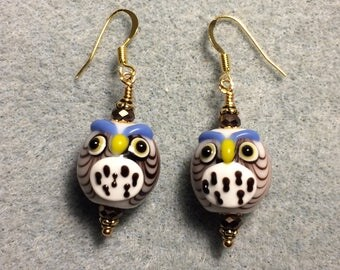 Brown and white lampwork spotted owl bead earrings adorned with brown Chinese crystal beads.