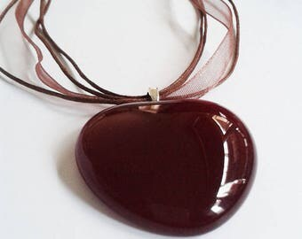 Red heart pendant, cast glass in a deep, dark red colour.