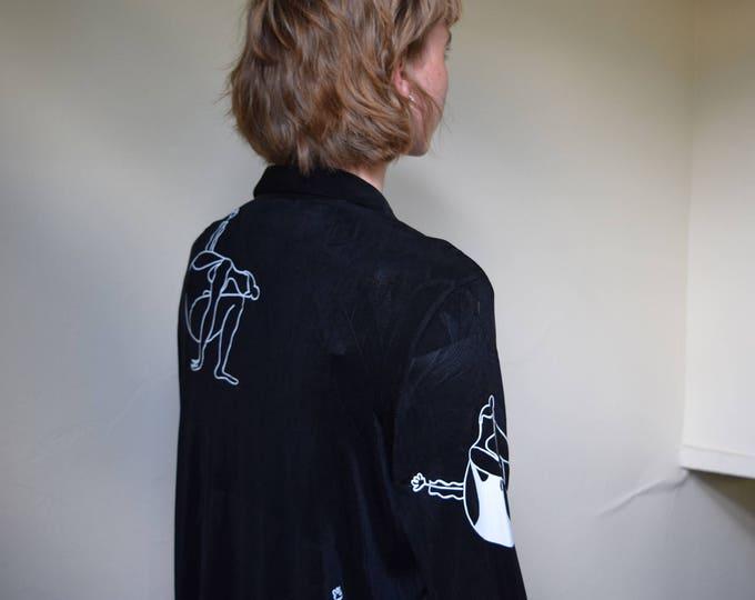 mara b. girl with vase black long sleeve blouse.