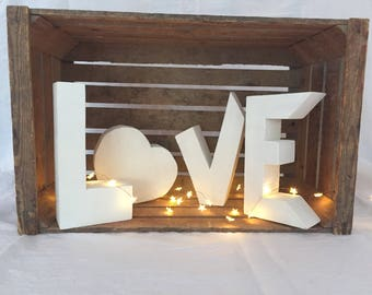 Love in wood-wood letters-drawn and hand-cut
