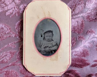 Paper framed tintype photo adorable grumpy baby that is quite evil