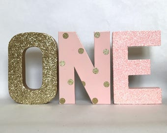"""Pink and Gold Glitter Stand Up """"ONE"""" Letter Sign -First Birthday -Photo Prop -Party Decor -Paper Mache Letters -Winter ONEderland-Decoration"""