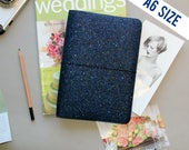A6 Traveler's Notebook Cover in Modern Navy Glitter.  Quad binding to fit up to 4 inserts.  Reversible with Matte Indigo Blue Lining.