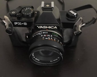 Yashica FX-3 35mm SLR Film Camera with 50mm Lens, case, manual, strap
