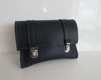 Blue leather belt pouch.