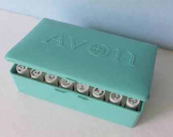"""Vintage Avon Full Lipstick Sample Case/ Aqua case with 40 colors from the 1960's or 1970's/ 5"""" W X 3.25"""" D X 1.5"""" H"""