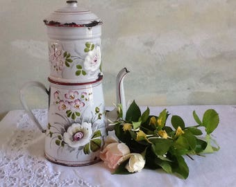 Stunning rare vintage french enamel coffee pot. Collectable french antique enamel coffee pot with filter. White and pink flowers.