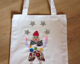 bag child's library with applied clown juggler with stars
