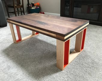 Walnut coffee table with maple legs