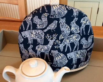 Tea cozy, tea cosy in navy blue with a gorgeous print of wildlife including Rabbit, Deer, Fox and Bear. Fits a two to four cup teapot.