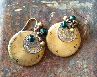Vintage watch face earrings with transit tokens