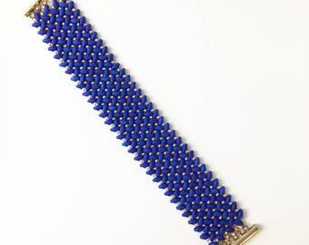 Bright Blue superduos and pink seed bead bracelet in simple elegant weave