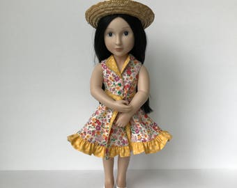 A Girl for All Time Reversible Sun Dress with tie belt and Straw Hat