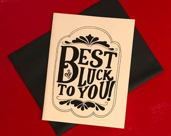 black and white hand lettered best of luck card