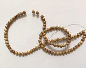 100 round 4 mm beige glass beads