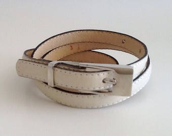 Vintage ivory leather narrow belt with white metal buckle and black trim by Stephen Collins