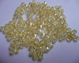 135 beads 4 mm bicones, Swarovski Crystal, yellow