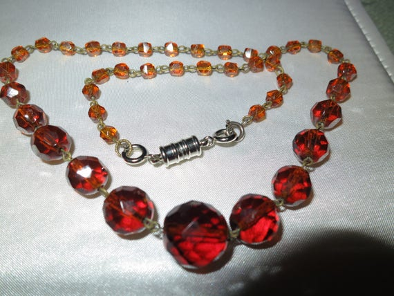 Stunning vintage Art Deco silvertone faceted cherry amber glass necklace