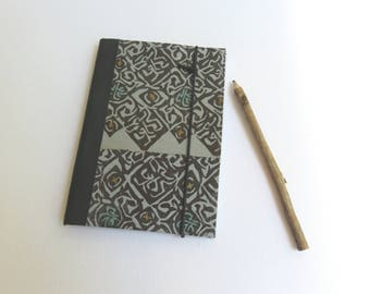 Notebook, white paper 80gr, 40 pages, elastic black, ethnic motif black and blue