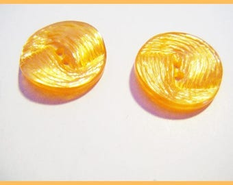 2 orange buttons - sewing