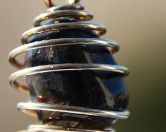 pietersite caged pendant