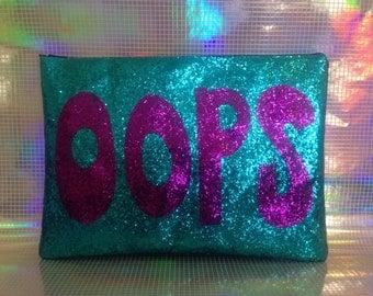 Oops glitter clutch bag
